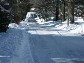 Snowy road after a snowplow