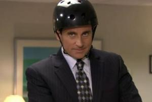A photo of office man with helmet on