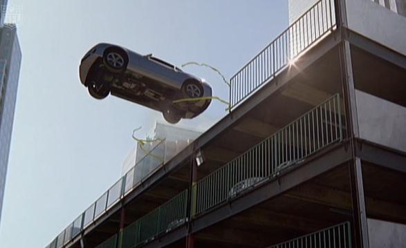Camaro ad shot of car driving off roof