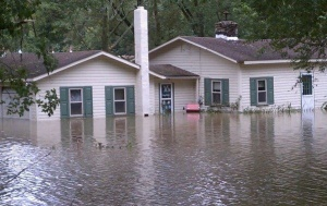 Photo of house half submerged in flood