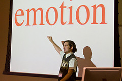 "Man in front of board pointing at ""emotion"""