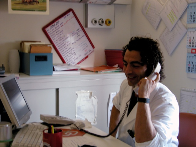 Doctor smiling and talking on phone