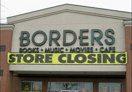 Photo of a Borders store with closing sign on it