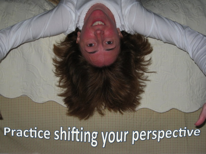 "Me hanging upside down with the words ""Practice shifting your perspective"""