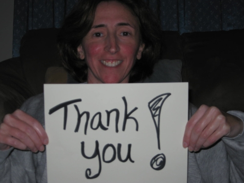 Photo of me with sign saying Thank You!