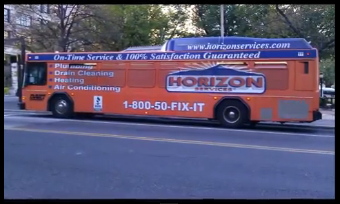 Bus wrapped in orange Horizon advertising